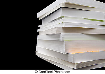 Paperback Books - Paperback books (manuals) on a black...