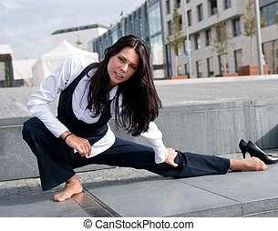 Stretching - woman exercising outside