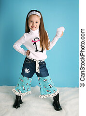 Cute toddler girl modeling a winter penguin outfit -...