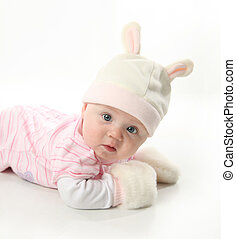 Baby bunny - Portrait of an adorable baby girl wearing a...