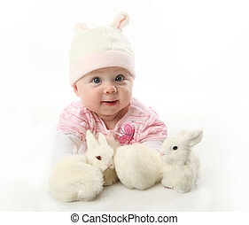 Baby and bunnies - Portrait of an adorable baby girl wearing...