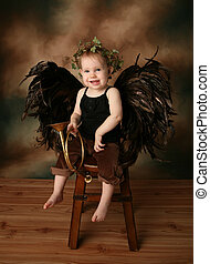 Little Angel Girl - Beautiful young girl wearing angel wings...