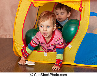 Playing in a toy house