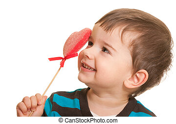 Shy Valentine - A cheerful laughing kid is holding a red...