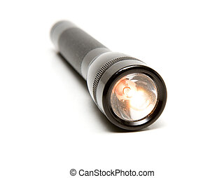 Aluminum Flashlight - Black rugged aluminum flashlight on a...
