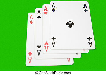 Four Aces - Winning playing cards, four aces, on green...