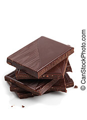 Dark chocolate - Stack of dark chocolate pieces on white...