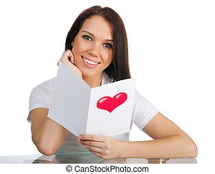 Cute young girl with a Valentine's card