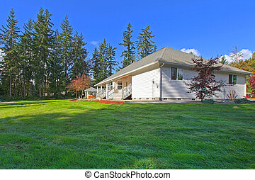 White home with large back yard