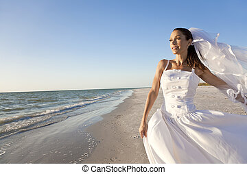 Bride at Beach Wedding - A married woman bride in her...