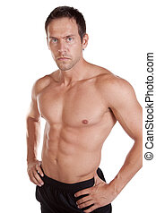 Man shirtless serious - A man is standing with his shirt off...
