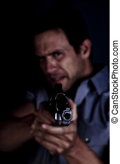 Mad man pointing gun - A man pointing a gun with an angry...