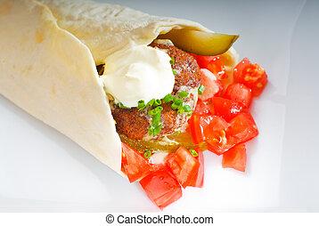 falafel wrap - fresh traditional falafel wrap on pita bread...