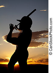 Silhouette baseball end swing sunset