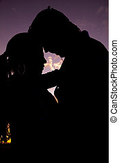 silhouette couple heads together - A silhouette of a couple...