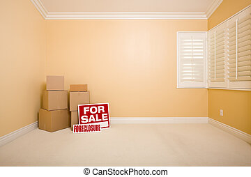 Boxes, Sale and Foreclosure Real Estate Signs in Empty Room...