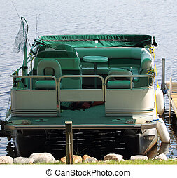 Pontoon Boat docked at Pier - A fishing pontoon boat docked...