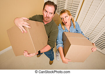 Exhausted Couple Holding Moving Boxes - Obviously Exhausted...