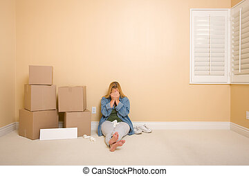 Upset Woman on Floor Next to Boxes and Blank Sign - Upset...