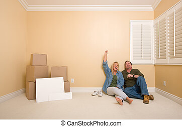 Couple on Floor Near Boxes and Blank Signs - Excited Couple...