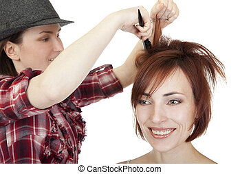 Stylist makes hairstyle.