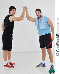 young adults exercise fitness - two young adults exercise...