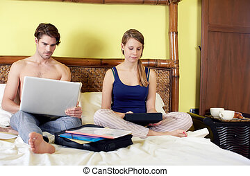 young couple working from home with pc - caucasian...