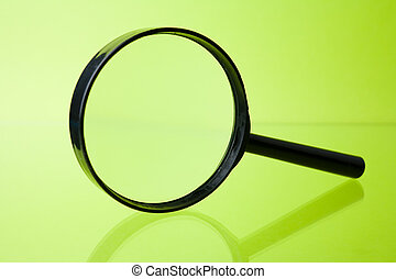 Magnifying Glass - Magnifying glass on green background