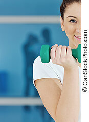 woman fitness workout with weights - beaudiful young woman...