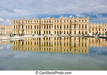 Chateau de Versailles reflected in water on a sunny day