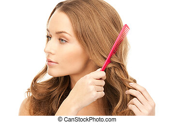 beautiful woman with comb - bright picture of beautiful...