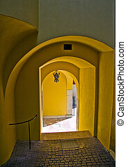 dAnnunzio Archway - Series of yellow painted archways and...