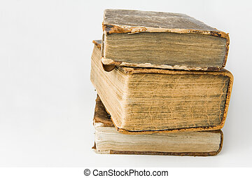 Antique Books - Antique books piled on a white background