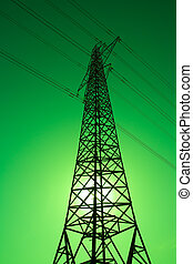 Green Power - Sun shining behind an electricity pylon Green...