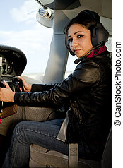 Woman at airplane controls - A woman is flying an airplane.