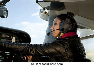Woman flying airplane - A woman is flying an airplane and...