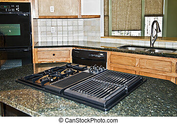 Kitchen Area - A kitchen cooktop area set into a granite...