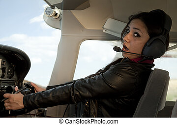 Woman scared flying airplane - A woman is scare and flying a...