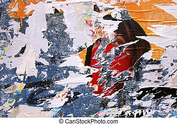 Urban decline - Stripped posters on old wall, vandalism and...