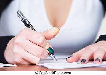 Writing girl - persons female hand signing an important...