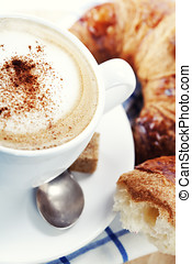coffee and croissants - Breakfast with coffee and croissants