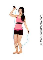 Trip rope - A woman is tripping on a jump rope.