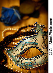 Venice mask - Ornate carnival mask on a music paper with...
