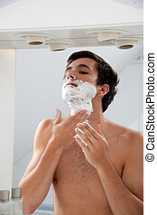 Man shaves with a razor blade And Rasierschau