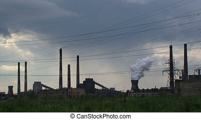 Polluting emissions - Factory pollutes the environment large...