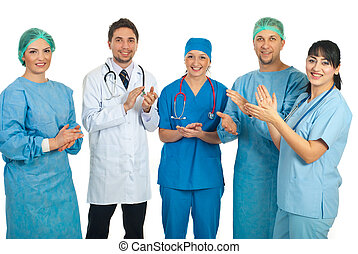 Doctors team applauding - Five different doctors standing in...