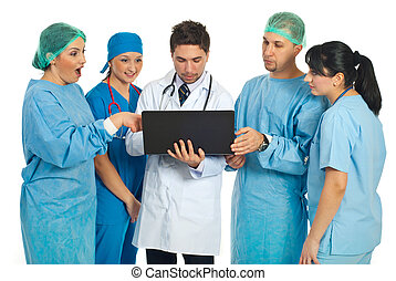 Team of doctors search on laptop - Team of doctors searching...