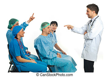 I know the answer! - Doctor teacher asking a doctor woman a...