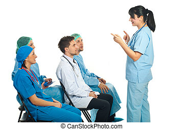 Physician woman explain in front of class - Physician woman...