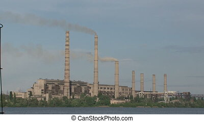 Bad ecology - Factory pollutes the air is right on the river...